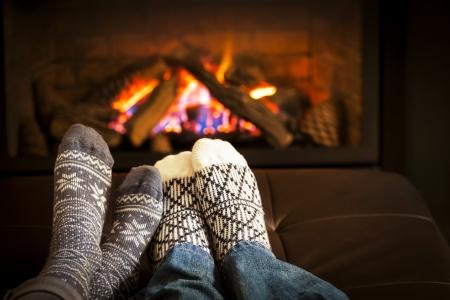 20240032 - feet in wool socks warming by cozy fire